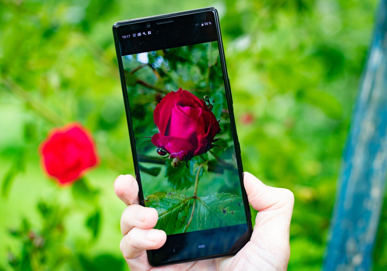 Lång mobil för foto och biokänsla